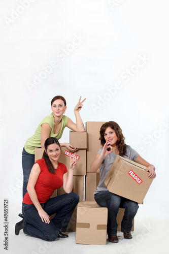 trio of female students moving in together