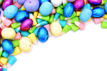 Colorful corner border of Easter candy over white