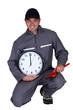 Tradesman holding a clock