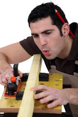 Carpenter planning  timber