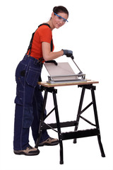Woman cutting tiles