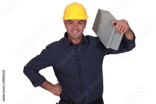 mason holding brick