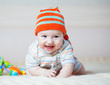 happy baby boy weared in hat