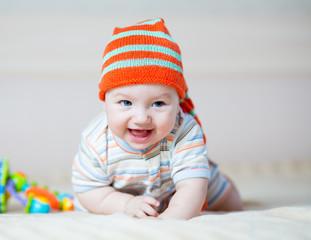happy baby boy weared in hat