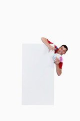 Man behind white panel with cash
