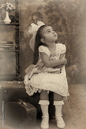 Little girl looking away in thought