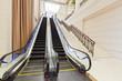Escalator in modern interior toned