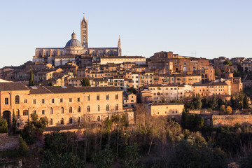 Old town of medieval Siena at sunset.