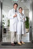 Medical Professionals Standing At Hospital Entrance
