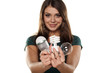 Smiling girl shows all three generations of light bulbs