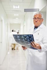 Radiologist Holding MRI X-ray