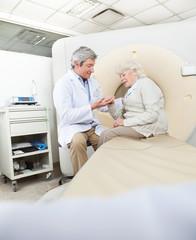 Radiologist Comforting Female Patient