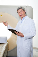 Doctor Presenting The CT Scan Machine