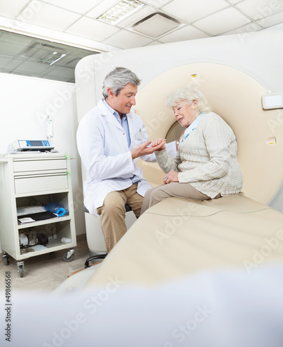 Radiologist Comforting Female Patient