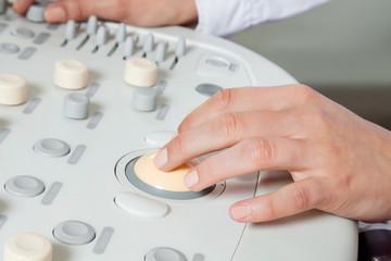 Female Radiologist Operating Ultrasound Machine