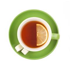 Green teacup with sugar and lemon.