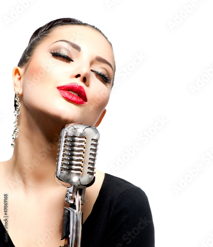 Singing Woman with Retro Microphone isolated on white