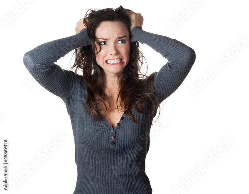 Frustrated woman pullinh ger hair