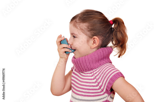 little girl with inhaler on white