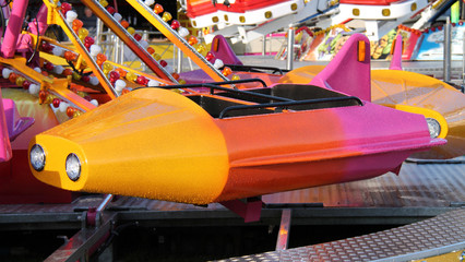 A Seat Carriage on a Fast Fun Fair Ride.