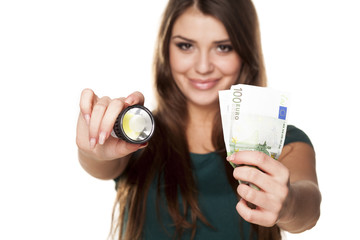 Smiling girl shows how you can save money with LED bulb