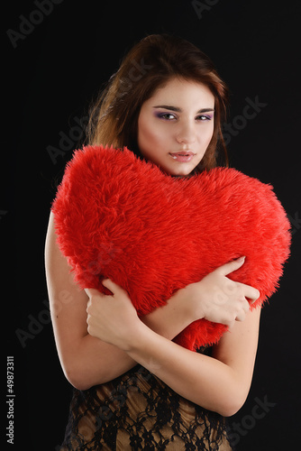teen girll with heart pillow