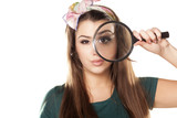 nice and beautiful girl looking through a magnifying glass