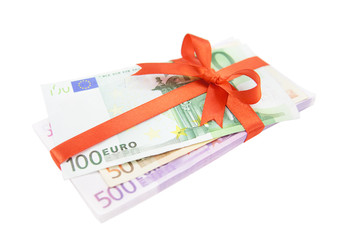 The euro money pile bound with a satin red ribbon and bow