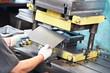 worker operating metal sheet press machine - 49873910
