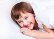 Laughing boy in bed