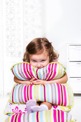 Toddler girl with pillows