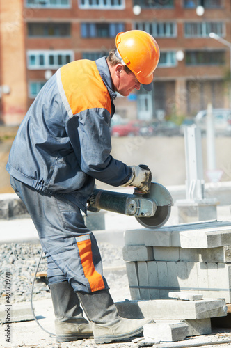 builder at cutting curb work