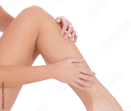 Woman sitting on the floor touch leg by hand
