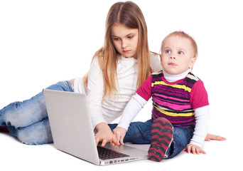 Brother and sister using laptop computer