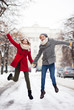 Couple jumping in snow