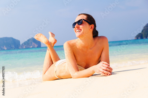 woman is lying on beach