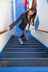 girl climbing the stairs of a ferry