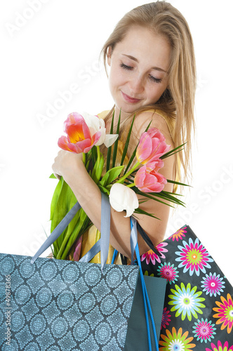 Portrait of happy smiling  girl with a bouquet of spring tulips.