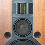 Loud speaker system with wood finish and metal black grills