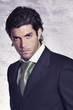 Elegant and stylish male model in black dress