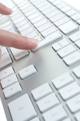 female hands touching computer keyboard