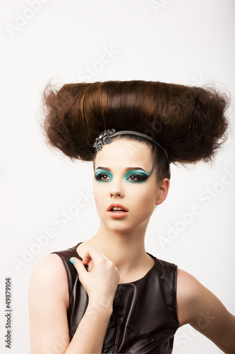 Glamour. Unusual Brunette with Extraordinary Festive Hairdo