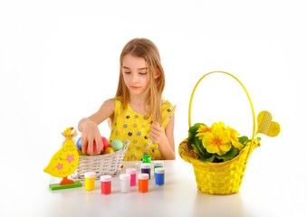 Little girl preparing Easter eggs