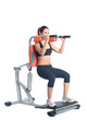 Sporty young woman on isodynamic exerciser