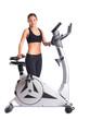 Brunette woman near bike  exerciser