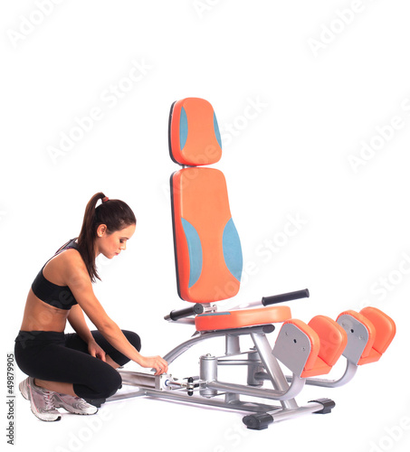 Sporty woman near  isodynamic exerciser