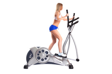 Slim blonde woman on exerciser