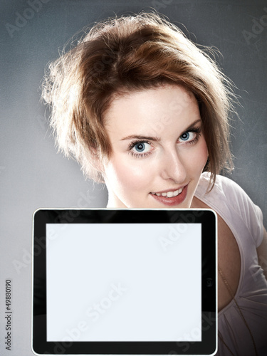 Beauty woman looking over her tablet pc with copyspace