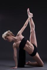 Slim dancer in black underwear