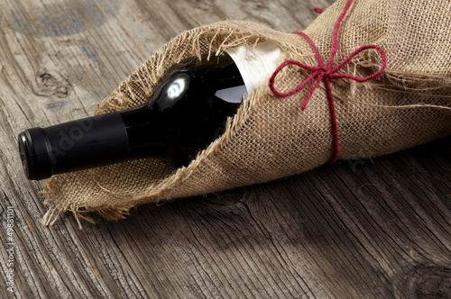 Red wine bottle wooden table